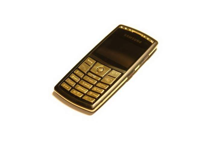 MJ Slim Mobile Phone - Diamonds, Ruby, Emerald, Solid Gold 585.